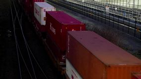 Top shot of freight train passing by Port Moody city. At night stock video footage