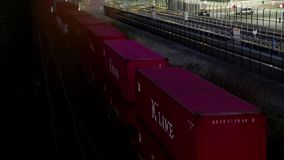 Top shot of freight train passing by Port Moody city. At night stock footage