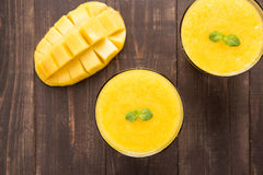 Top shot mango smoothie on wooden table Royalty Free Stock Photography