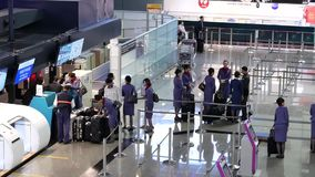 Top shot of passengers going to the China airline check in desks i. Nside Taiwan airport stock video