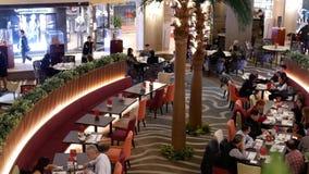 Top shot of people enjoy food inside Chinese restaurant