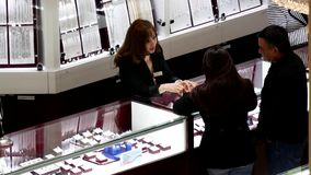 Top shot of people shopping jewelry stock video