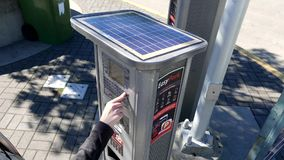 Top shot of solar panels with woman pressing plate number for paying parking fee stock video