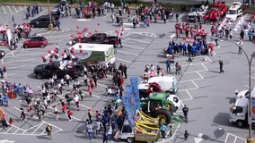 Top shot of Tri-City Chinese Canadian association parading on the street. In Coquitlam BC Canada stock footage