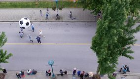 Top shot of Tri-City Chinese Canadian association parading. On the street stock video