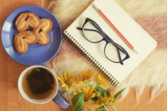 Top shot of writer breakfast with notebook Stock Photo