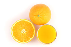 Top side orange juice and half of orange. On white background Royalty Free Stock Photo