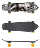 A top and side view of a skateboard Stock Photography