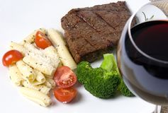 Top Sirlion. A grilled top sirloin steak....medium....with pasta, broccoli and wine Royalty Free Stock Photo