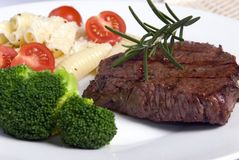 Top Sirloin 2. A grilled top Sirloin steak with broccoli and pasta Royalty Free Stock Image
