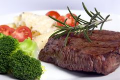 Top Sirloin 4. A grilled top sirloin steak .. medium with broccoli and fresh pasta Stock Image