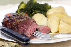 Top Sirloin Steak. A grilled top sirloin steak .. medium with broccoli and fresh baby potatoes Stock Photography