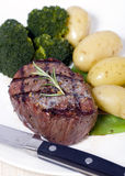 Top Sirloin Steak. A grilled top sirloin steak .. medium with broccoli and fresh baby potatoes Stock Image