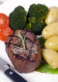 Top Sirloin Steak. A grilled top sirloin steak .. medium with broccoli and fresh baby potatoes Stock Images