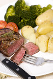 Top Sirloin Steak. A grilled top sirloin steak .. medium with broccoli and fresh baby potatoes Stock Photos