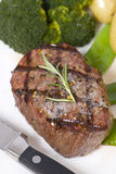 Top Sirloin Steak. A grilled top sirloin steak .. medium with broccoli and fresh baby potatoes Royalty Free Stock Photo