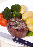 Top Sirloin Steak. A grilled top sirloin steak .. medium with broccoli and fresh baby potatoes Royalty Free Stock Image