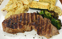 Top Sirloin Steak Dinner. Grilled Beef Steak With Vegetables Stock Photos