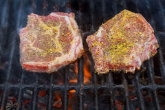 A top sirloin steak flame broiled on a barbecue, royalty free stock photos