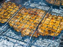Barbecue on the grill. A top sirloin steak flame broiled on a barbecue, shallow depth of field Royalty Free Stock Image
