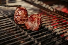 A top sirloin steak flame broiled on a barbecue, shallow depth of field. royalty free stock photos