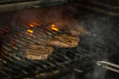 A top sirloin steak flame broiled on a barbecue. Shallow depth of field stock photos