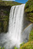 On top of Skogafoss waterfall with rainbow Stock Photography
