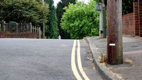 The Top of a Sloped Road Showing the Angle leaning towards the Kerb. royalty free stock images