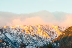 Top of snow mountain with sunrise. Royalty Free Stock Images