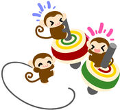 Top spinning by monkeys Royalty Free Stock Photography