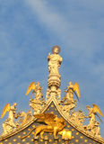 The top Of St Mark's Basilica in Venice. Showing St. Mark, his retinue of angels and a winged lion Royalty Free Stock Images