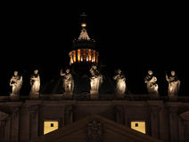Top of St. Peter's Basilica. The top of St. Peter's Basilica, in Vatican city at night, featuring the statues and the top of it's dome Royalty Free Stock Photo