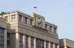 Top of the State Duma Building with flag on roof Royalty Free Stock Photos