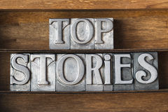 Top stories tray. Top stories phrase made from metallic letterpress type on wooden tray Royalty Free Stock Photography