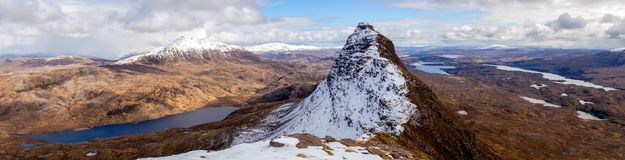 On top of Suilven Mountain in Scotland. Panoramic view with snow royalty free stock image