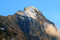 Top of the sunny Swiss Eiger against blue sky stock photos