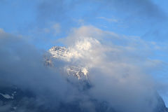 Top of the Swiss Eiger against blue cloudy sky Stock Photo