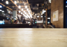 Top of table with Bar Cafe Restaurant blurred background. Top of Wooden table with Blurred Bar Cafe Restaurant background Royalty Free Stock Photography