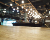 Top of table with Bar Cafe Restaurant blurred background. Top of wooden table with Bar Cafe Restaurant Interior Blurred background Stock Photography