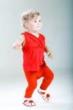 Top-top. Walking happy child. Studio shoot Royalty Free Stock Photography