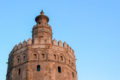 Top of Torre del Oro under a clear blue sky, Sevilla. NThe tower was built in XIII century, and had many roles, such as military watchtower and prison. Nowadays royalty free stock images