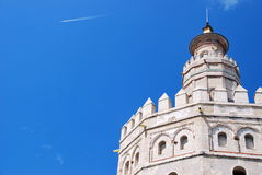 Top of the Torre del Oro. Top view of the Golden Tower over a blue sky in Seville, Spain Royalty Free Stock Image