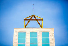Top of tower building on blue sky Royalty Free Stock Photos