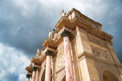 Top of the triumphal arch of the Carrousel in Paris. Top of the triumphal arch of the Carrousel against cloudy sky in Paris Royalty Free Stock Photo