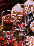 Top two glass latte mug hot drink with red berry. Top of two glass latte mug hot drink. Warming mulled wine with cookie in form of house and red berry royalty free stock photos