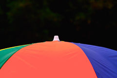 Umbrella stock photos. Beautiful top of an umbrella with colourful clothes background photograph royalty free stock photos