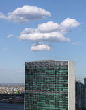 Top of United nations secretariat building with puffy white clou Royalty Free Stock Image