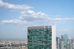 Top of United nations secretariat building with puffy white clou Stock Image
