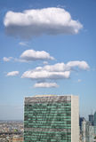 Top of United nations secretariat building with puffy white clou Royalty Free Stock Images