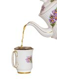 Top up. Filling a tea cup to the brim stock images